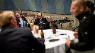 Andy Bowers (center) at a live taping of the Political Gabfest at Grinnell College in 2011. Foreground, left to right: John Dickerson, David Plotz, Emily Bazelon