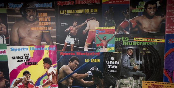 """Large posters of mostly Sports Illustrated magazine covers are displayed at the """"I Am The Greatest, Muhammad Ali"""" exhibition at the O2 arena, which hosts high profile boxing fights in London, Saturday, June 4, 2016. Ali, the magnificent heavyweight champion whose fast fists and irrepressible personality transcended sports and captivated the world, died according to a statement released Friday by his family. He was 74. (AP Photo/Matt Dunham)"""