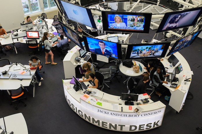 Students work at the new Jacki and Gilbert Cisneros assignment desk in the new Wallis Annenberg media center.