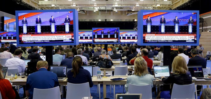 Reporters work in the media filing room during the Republican presidential debate sponsored by CNN, Salem Media Group and the Washington Times at the University of Miami, Thursday, March 10, 2016, in Coral Gables, Fla. (AP Photo/Alan Diaz)
