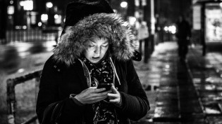 berlin-woman-reading-phone-cc