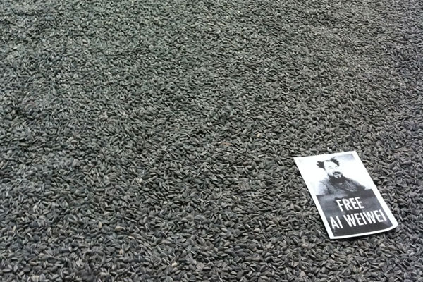 """Free Ai Weiwei"" posters were scattered upon the sunflower seeds in Ai's exhibit at the Tate Modern."