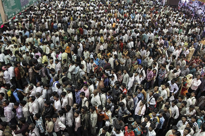 Indians crowd ticket counters at the railway station in Ahmadabad, India, Sunday, Oct. 23, 2011. The train stations are experiencing heavy crowd ahead of Diwali festival which will be celebrated on Oct. 26. (AP Photo/Ajit Solanki)
