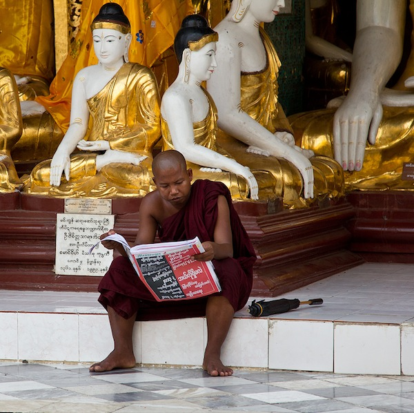 monk-reading-newspaper-yangon-burma-myanmar-cc
