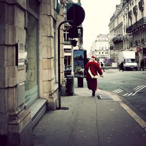 Santa running down the street in Algers, France