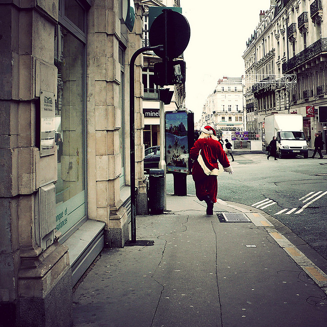 Santa running down the street in Algers, France