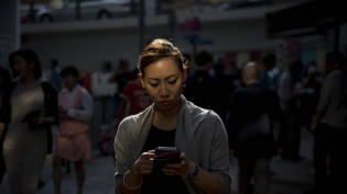 woman-looks-at-phone-vii-credit